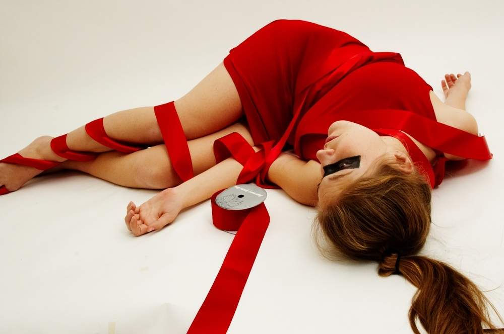woman-bound-in-red-ribbon.jpg