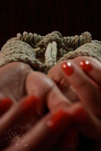 woman's-hands-tied-in-rope-small