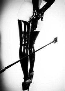 woman with leather and riding crop