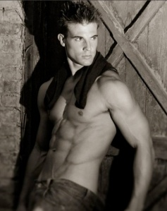 blond guy in barn