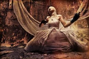 Girl behind mask and sheets